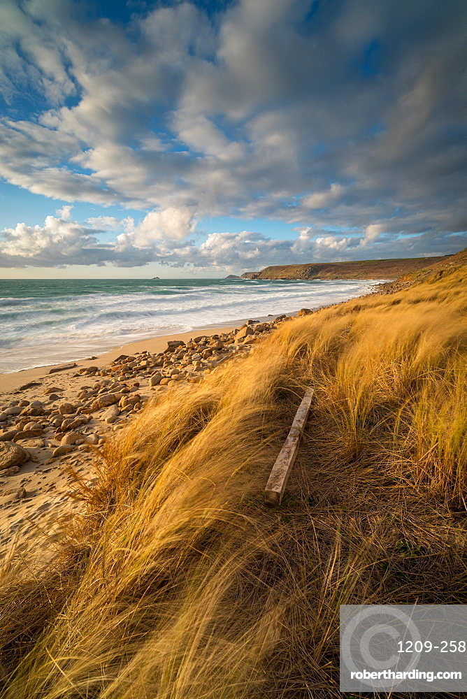 Fence post in foreground, with Brissons and Cape Cornwall in the far distance, Sennen Beach, Sennen, Cornwall, England, United Kingdom, Europe
