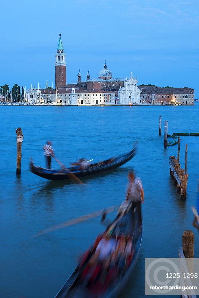 Gondolas near San Marco at twilight with San Giorgio in the distance, Venice, UNESCO World Heritage Site, Veneto, Italy, Europe