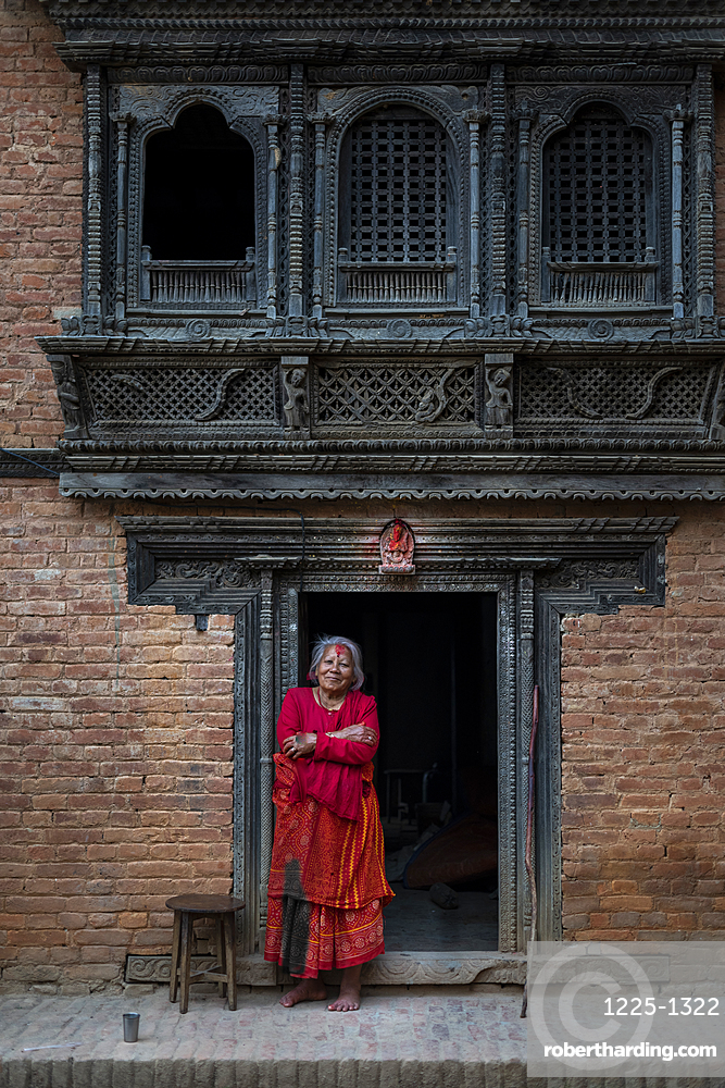 Traditional decorative Newari hand carved wood windows and architecture on a temple in an historical little village, Nuwacot, Nepal, Asia