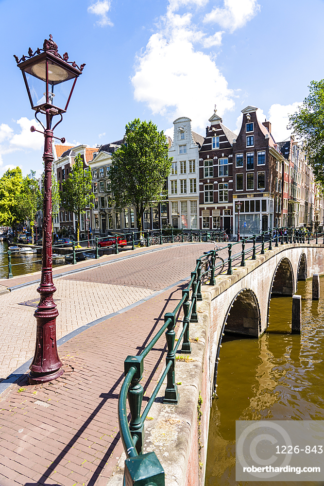 Old gabled buildings and bridge over Keisersgracht canal, Amsterdam, Netherlands
