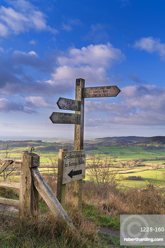 Signpost and distant view of the Vale of York from Whitestone Cliff, North Yorkshire Moors, Yorkshire, England, United Kingdom, Europe