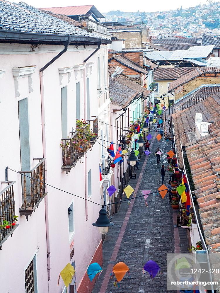 One of the narrow cobbled streets of Quito's historic centre, Quito, Ecuador, South America