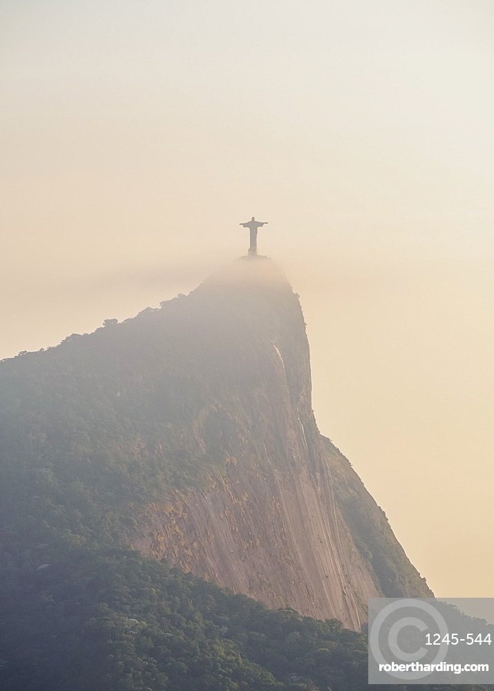 Christ the Redeemer and Corcovado Mountain at sunrise, Rio de Janeiro, Brazil, South America