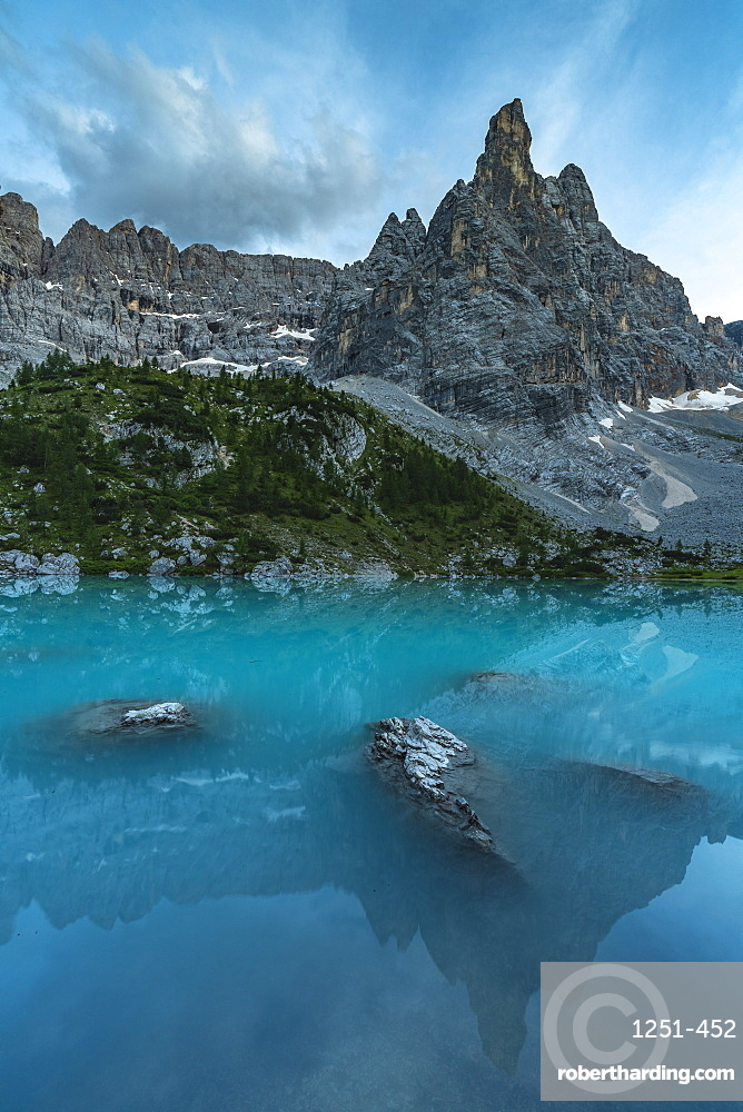 Reflection of Sorapis Group on Sorapis Lake at dusk in summer. Cortina d'Ampezzo, Belluno province, Veneto, Italy.
