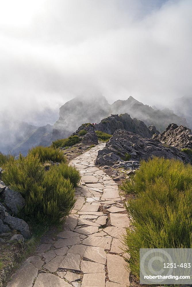Mist on the mountains of Vereda do Areeiro, the trail that links Pico Ruivo to Pico do Arieiro. Funchal, Madeira, Portugal.