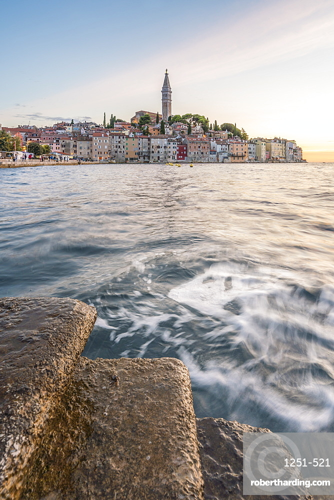 The old town at sunset, in summer, with stone steps in the foreground. Rovinj, Istria county, Croatia.