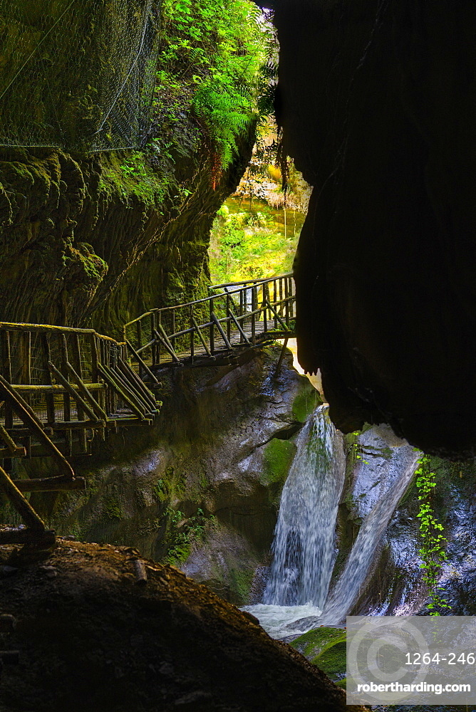 Caglieron caves, waterfall and wooden trail in the caves, Veneto, Italy, Europe