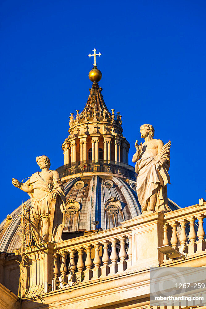 St Peter's Cathedral Cupola and statues in early morning light. Vatican city, Rome, Lazio, Italy.