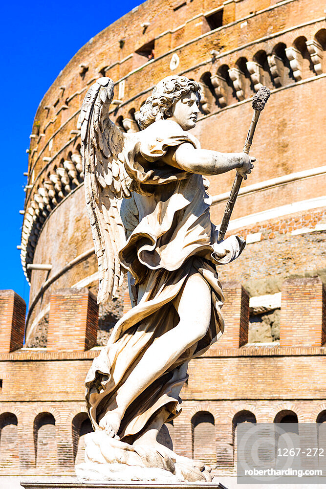 An angel statue from Ponte Sant'Angelo - Angels bridge, with Castle of the Holy Angel or Castel Sant???Angelo, Rome, Lazio, Italy.
