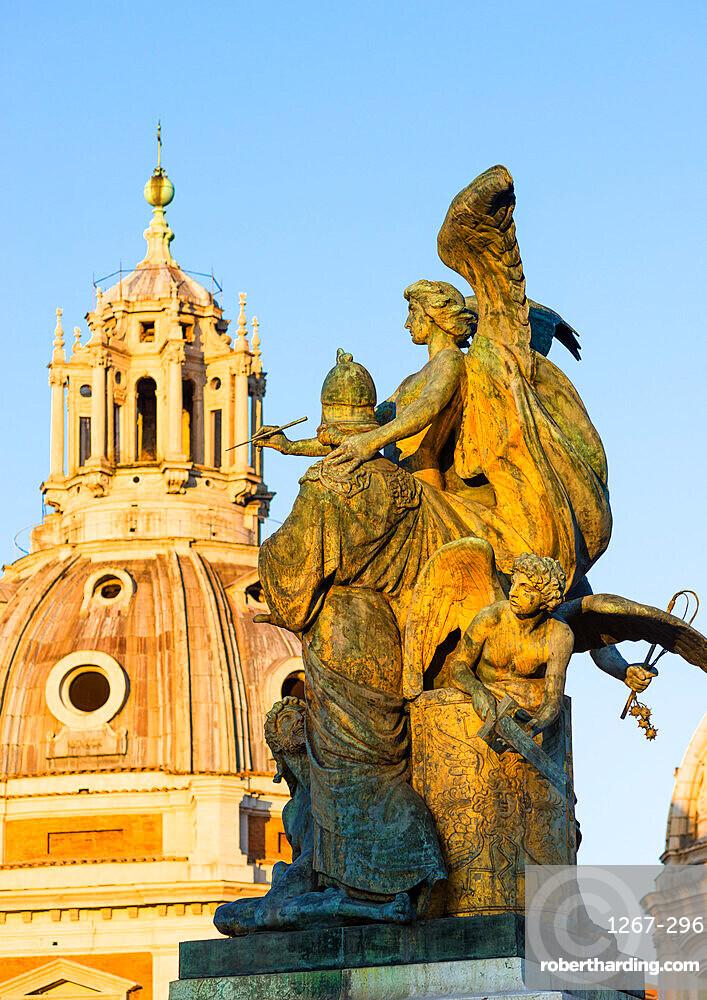 Bronze sculpture at the entrance to Monumento Nazionale a Vittorio Emanuele II with the Church of Santa Maria di Loreto, Rome, Lazio, Italy, Europe