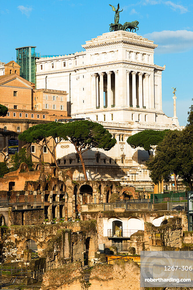 Roman Forum ruins in the foreground, UNESCO World Heritage Site, with Momument to Victor Emanuelle II behind, Rome, Lazio, Italy, Europe