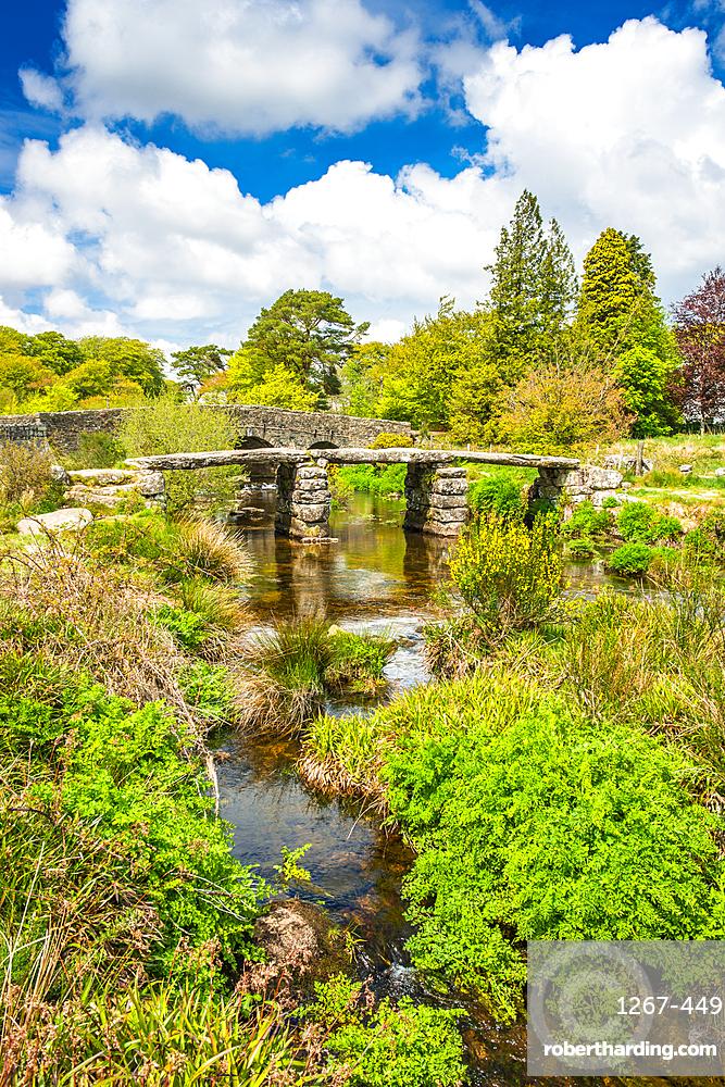 Medieval clapper bridge over the East Dart River at Postbridge on Dartmoor in Devon, West Country, England, UK