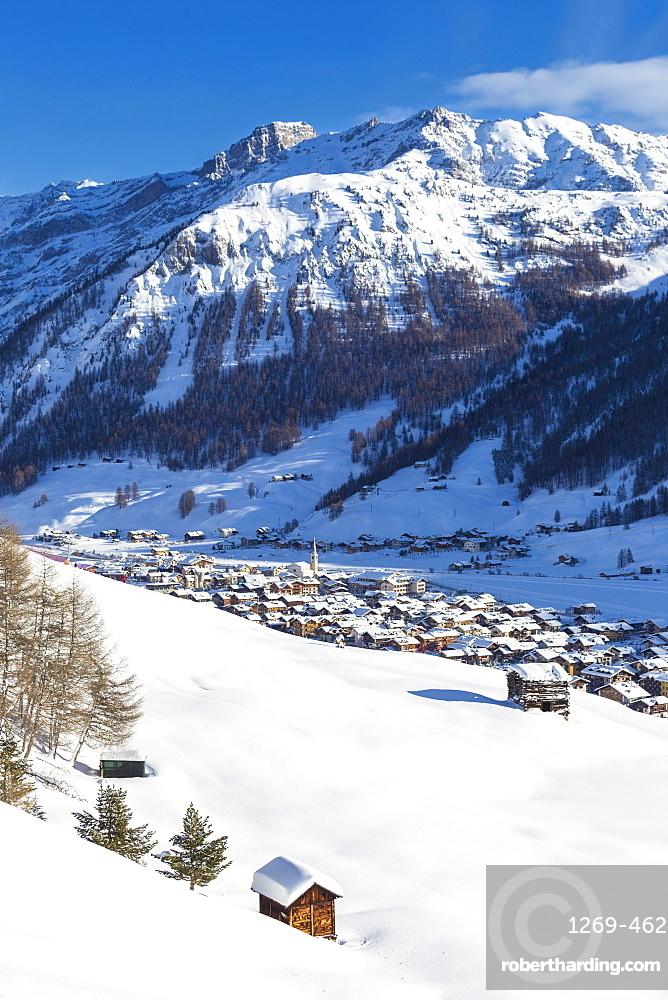 Village illuminated by sun after a snowfall, Livigno, Valtellina, Lombardy, Italy, Europe