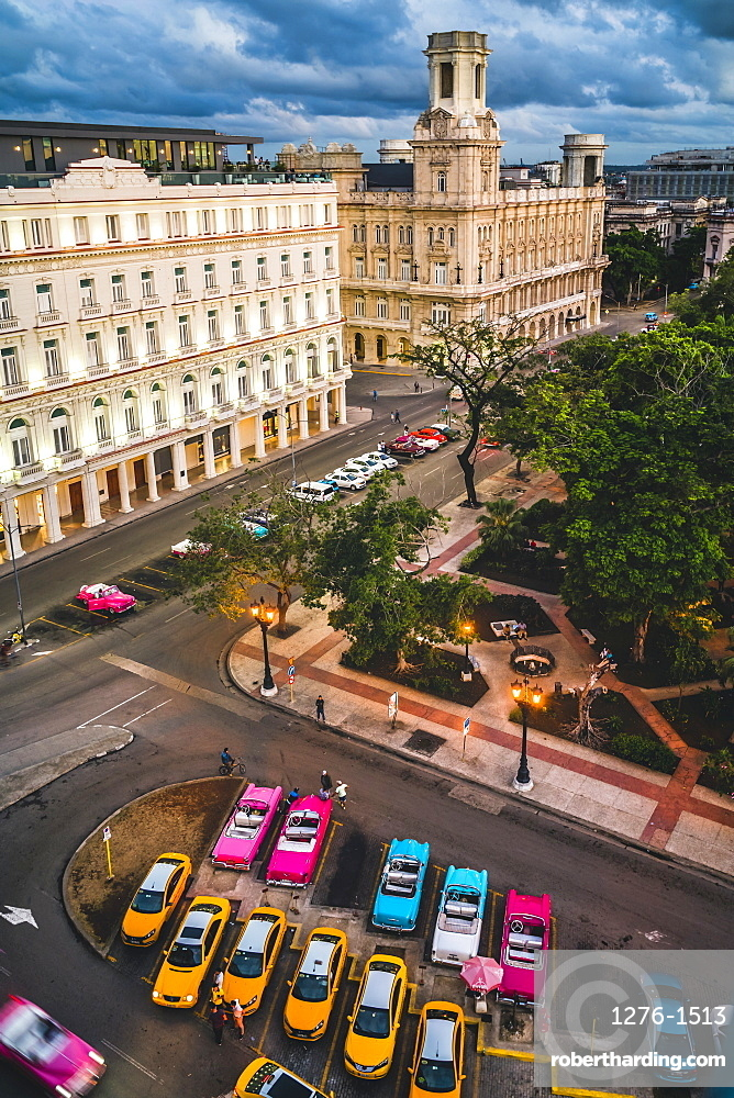 Aerial view colourful old American taxi cars parked in Havana at dusk, La Habana, Cuba, West Indies, Caribbean
