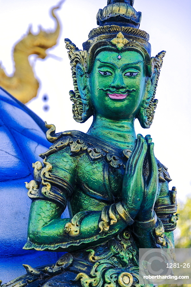 Green Yaksha statue at Wat Rong Suea Ten (Blue Temple) in Chiang Rai Thailand SE Asia