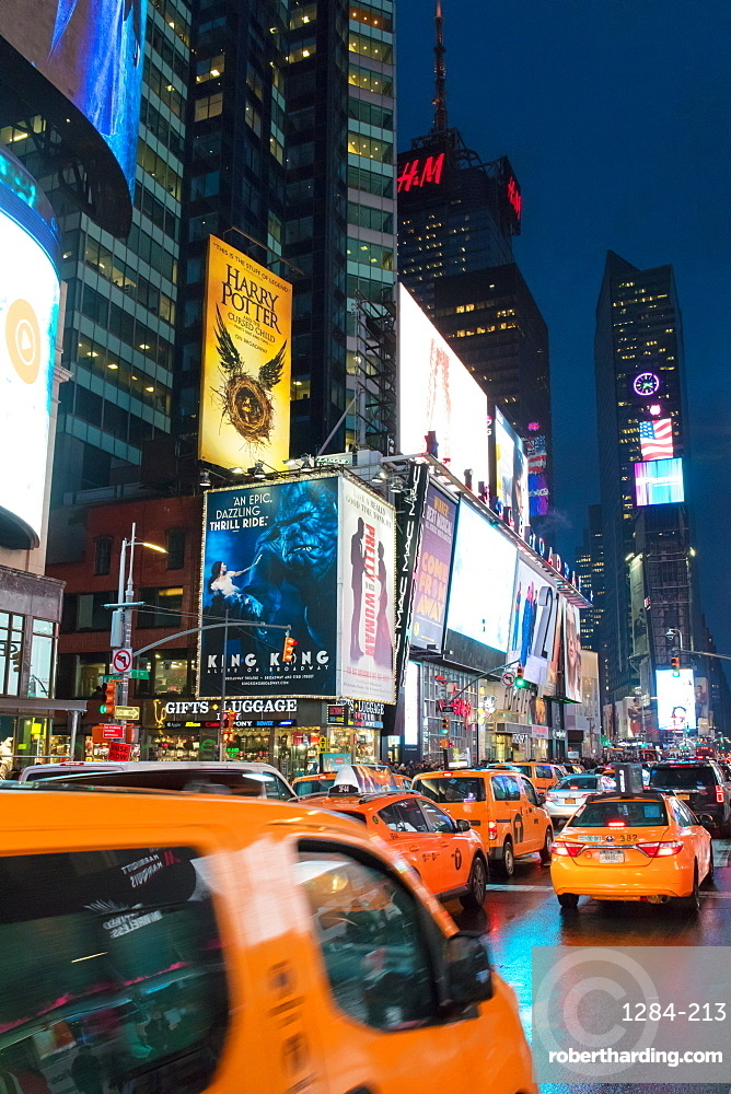 Yellow taxis in Times Square at night. New York City, New York, United States of America