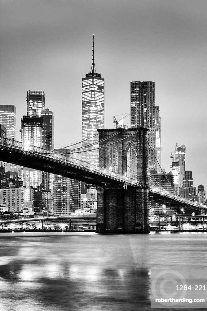 Brooklyn Bridge with 1 World Trade Centre in the background. New York City, New York, United States of America
