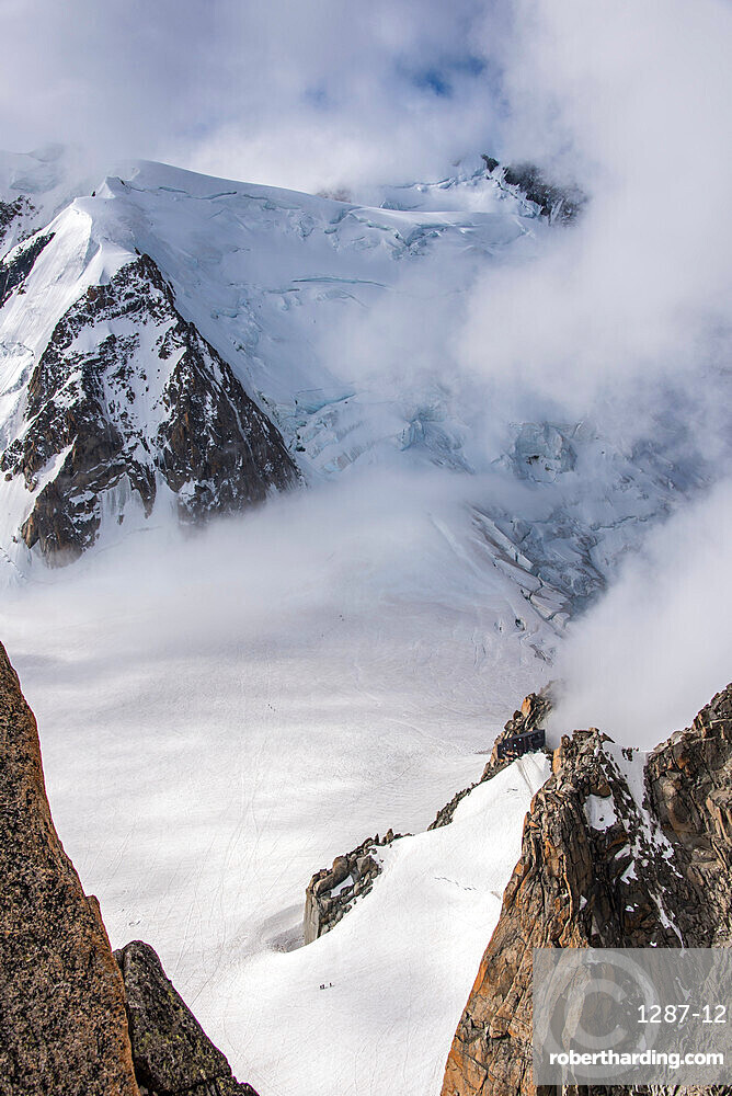 Looking down to the Vallee Blanche and the Cosmiques Hut used by climbers on Mont Blanc, small figures are seen in the valley, Chamonix, Haute Savoie, Rhone Alpes, France, Europe