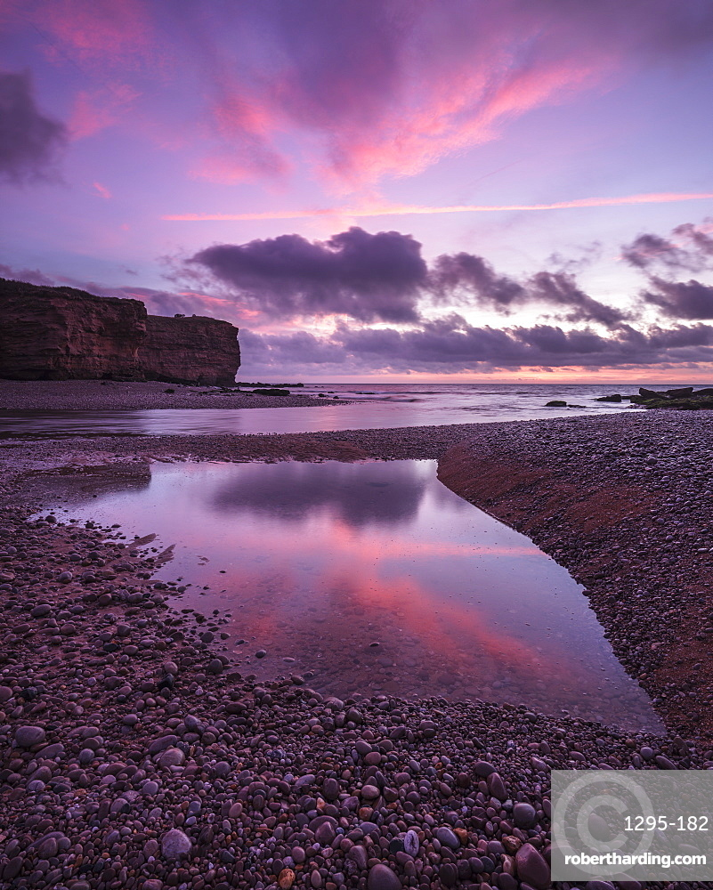 Dawn clouds at mouth of River Otter at Budliegh Salterton, Devon, UK