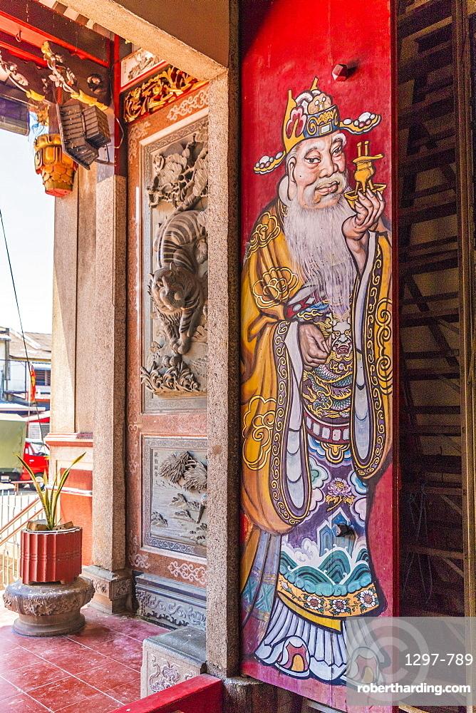 An ornate colourful door at Eng Chuan Tong Tan Kongsi clan house in George Town, Penang Island, Malaysia, Southeast Asia, Asia.
