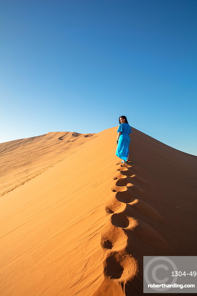 Model climbing Dune 13, Sossusvlei, Namibia, Africa