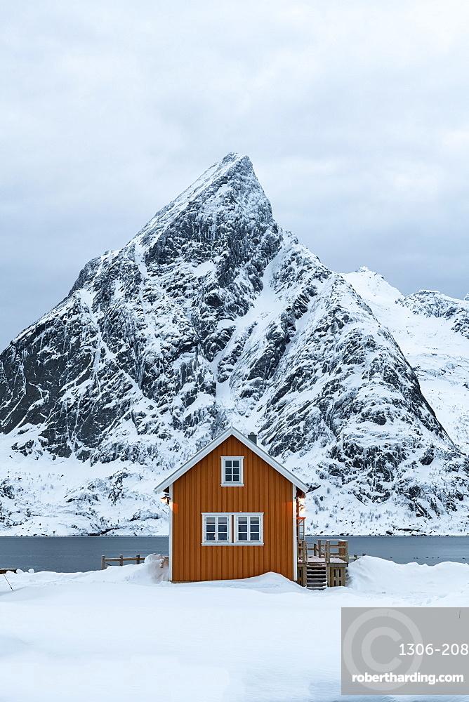 Yellow rorbuer hut in the snow, Sakrisoy, Moskenesoya, Lofoten Islands, Nordland, Arctic, Norway, Europe