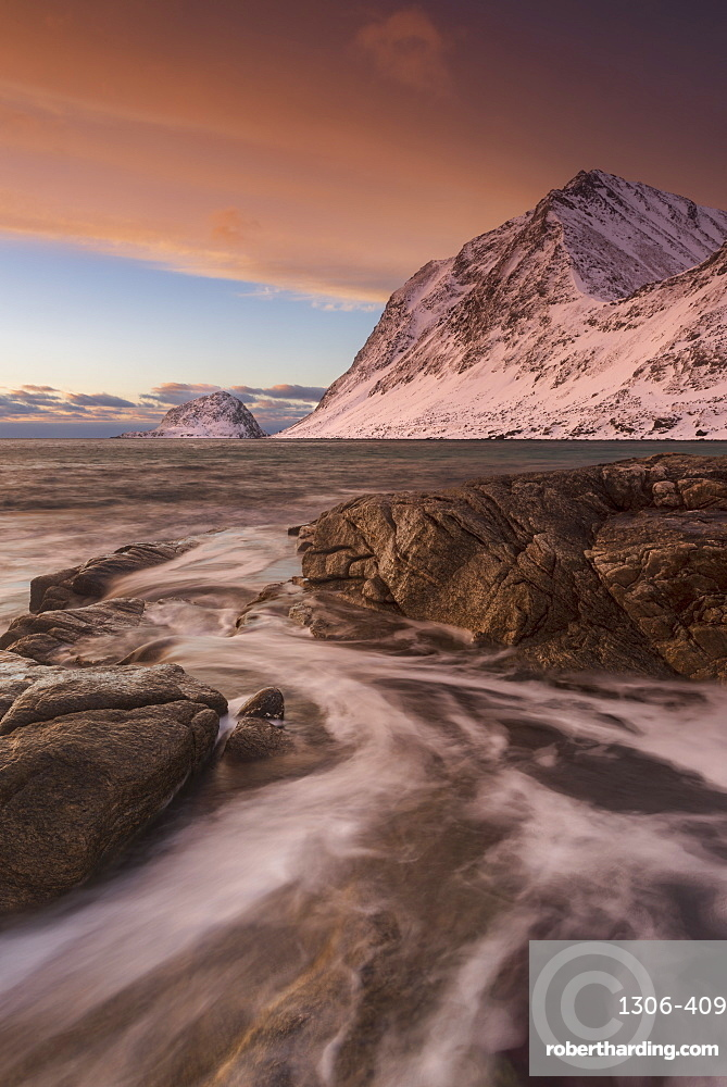 A dramatic sunset at Haukland Beach in winter, Lofoten, Nordland, Arctic, Norway, Europe