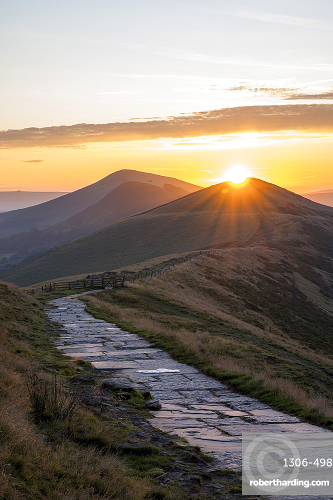 The sun rising directly above Lose Hill and Back Tor, The Peak District National Park, Derbyshire.