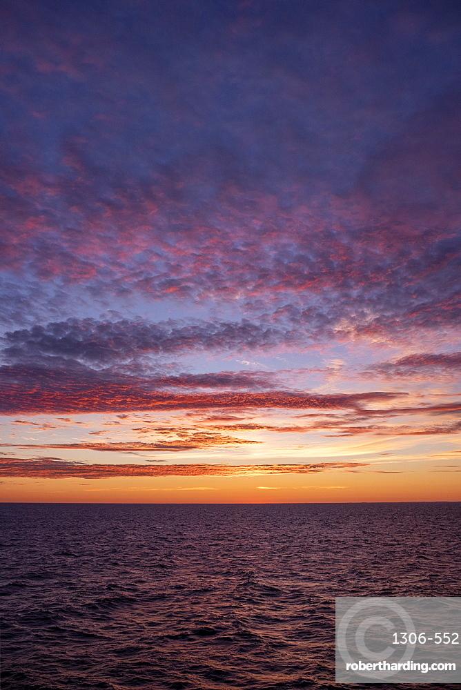 The midnight sun setting over Baltic Sea, Atlantic Ocean, Russia