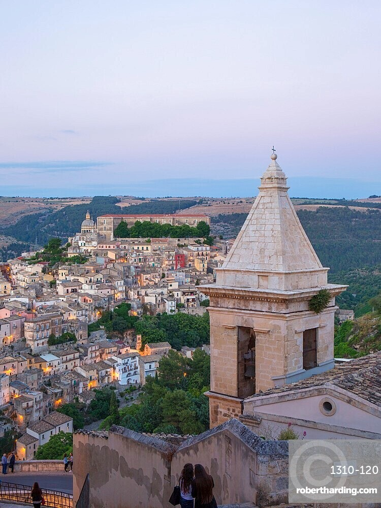 View over Ragusa Ibla, dusk, bell-tower of the Church of Santa Maria delle Scale in foreground, Ragusa, Sicily, Italy