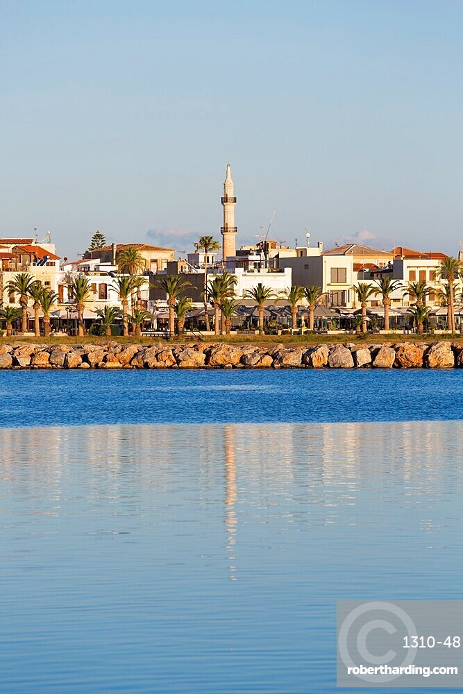 View to the waterfront, early morning, minaret of the Neratzes Mosque reflected in water, Rethymno (Rethymnon), Crete, Greek Islands, Greece, Europe