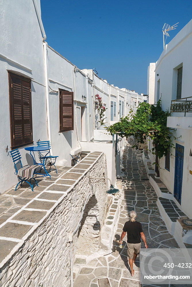 Man with paint walking through traditional Greek houses, Kastro Village, Sifnos, Cyclades, Greek Islands, Greece, Europe