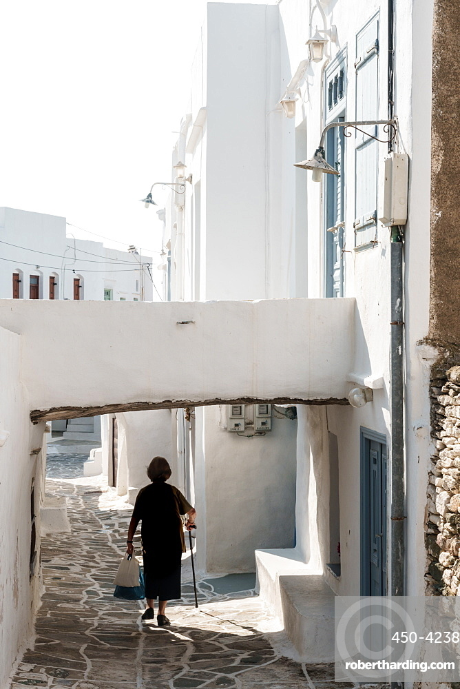 Old lady in black with stick and shopping walking home, Kastro Village, Sifnos, Cyclades, Greek Islands, Greece, Europe