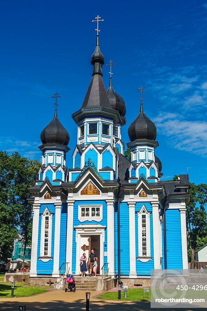 Family leaving Russian Orthodox Church at Drushkinkai, a spa town, Southern Lithuania, Europe