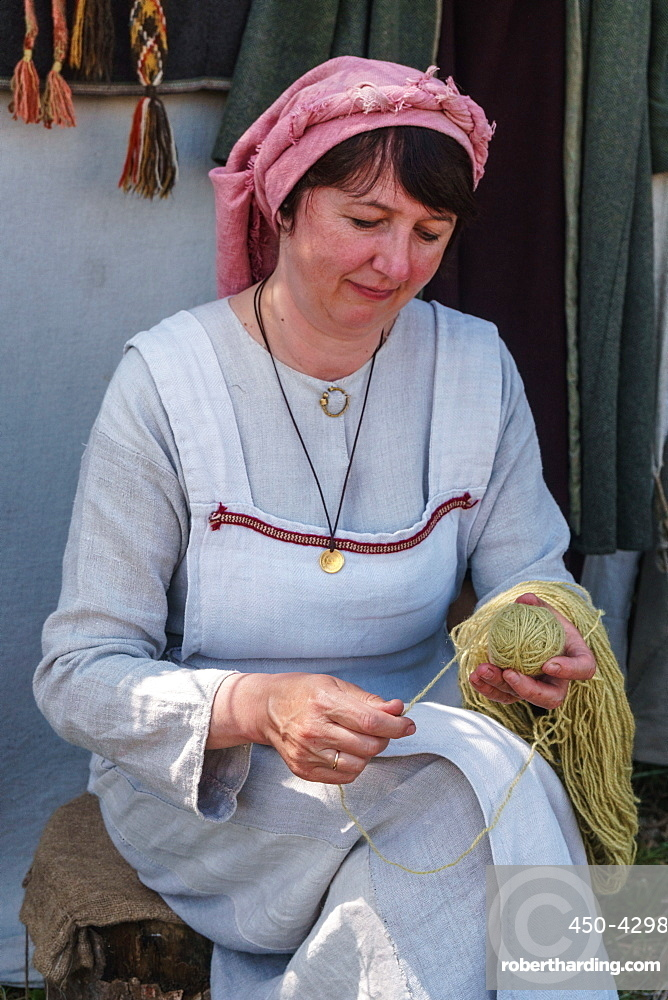 Weaver from Belarus at the International Festival of Experimental Archaeology, Kernave, Lithuania, Europe