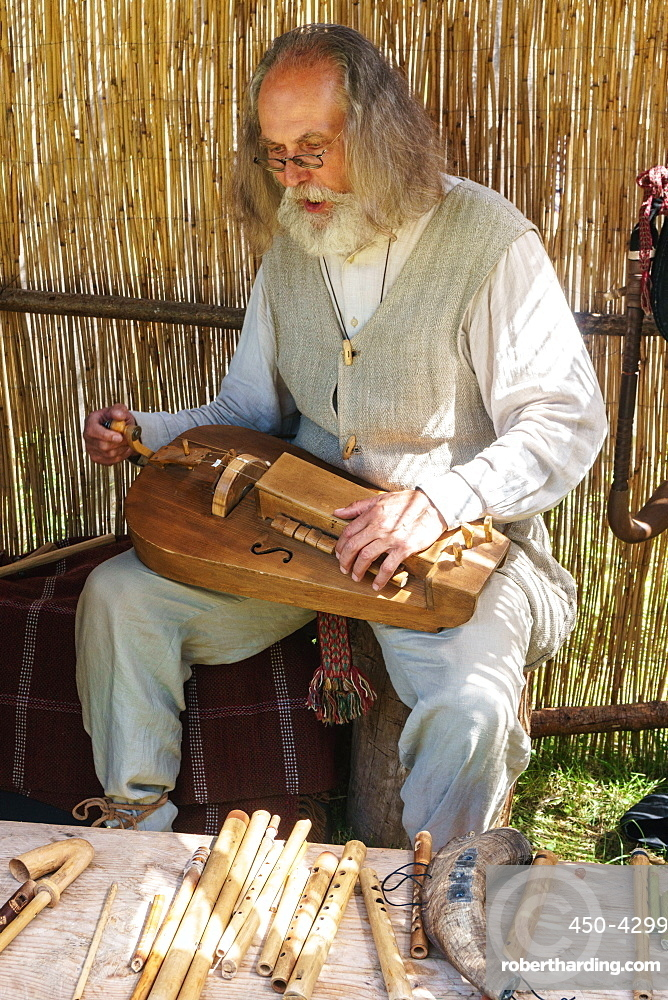 Lithuanian folk musician at the International Festival of Experimental Archaeology, Kernave, Lithuania, Europe