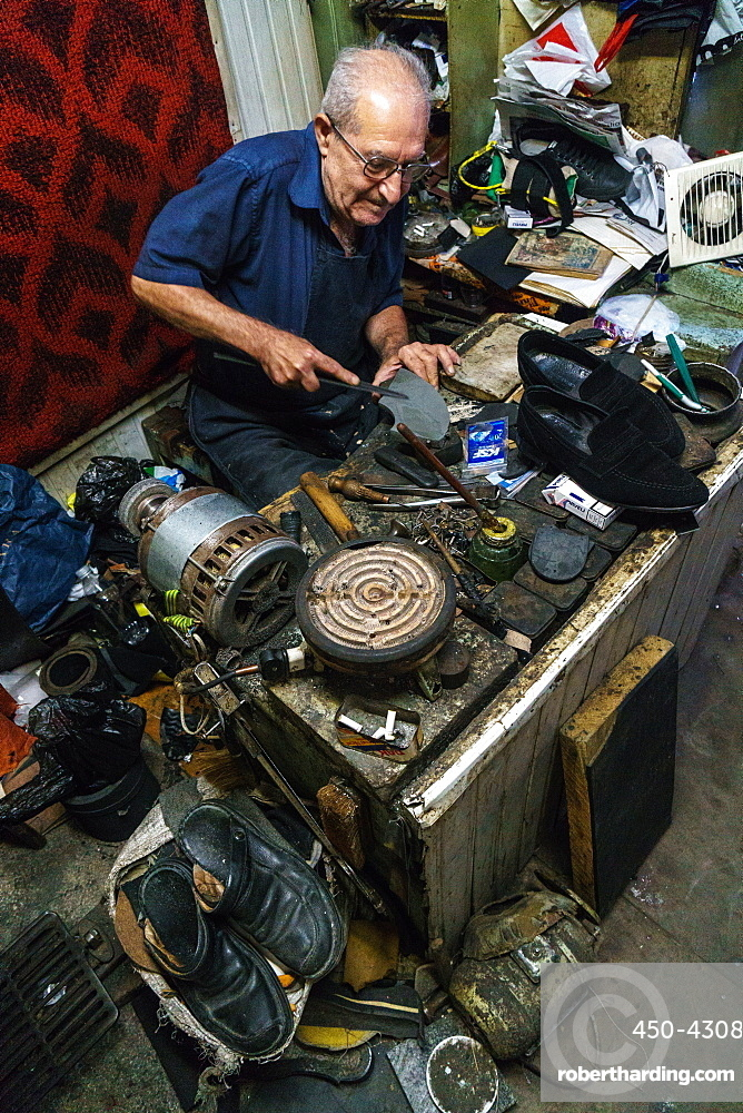 Armenian shoe repairer at work in his shop on Jerusalem Street, Old Town, Tbilisi, Georgia, Central Asia, Asia