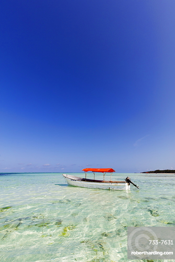 Small boat in crystal clear water, Pingwe, Island of Zanzibar, Tanzania, East Africa, Africa