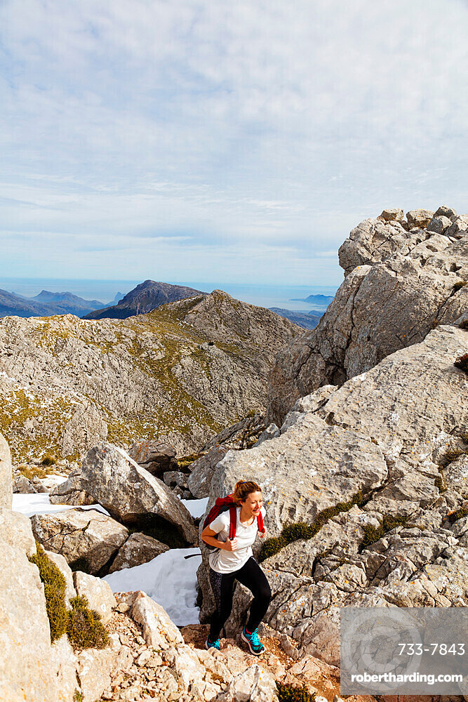 Serra de Tramuntura, hiker on Puig de Massanella Mallorca's highest accessible peak, Majorca, Balearic Islands, Spain, Mediterranean, Europe