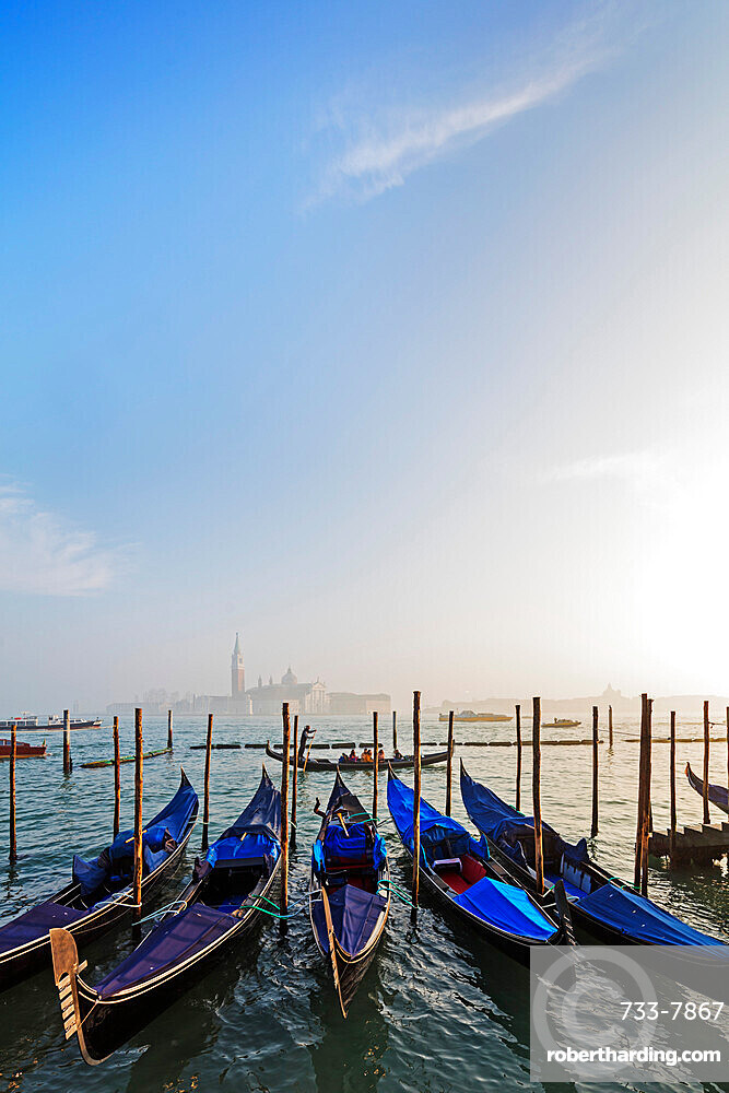 Gondola and San Giorgio Maggiore Church across Basino di San Marco, Venice, UNESCO World Heritage Site, Veneto, Italy, Europe