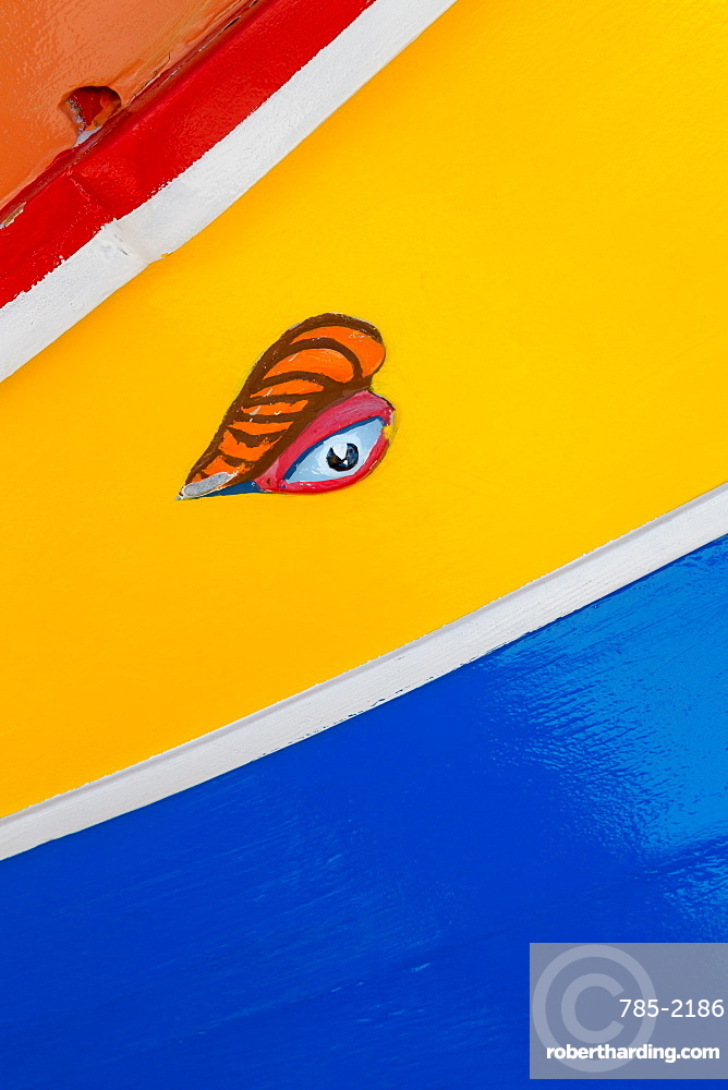 Detail of traditional, brightly painted, fishing boat in the harbour at Marsaxlokk
