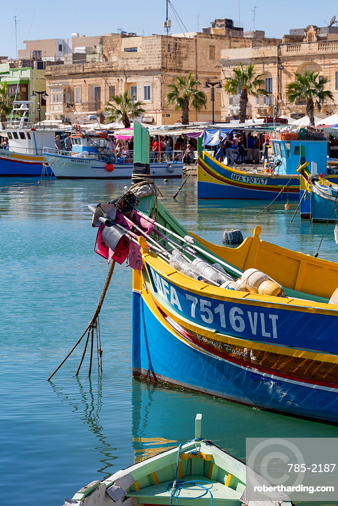 Traditional brightly painted fishing boats in the harbour at Marsaxlokk, Malta, Mediterranean, Europe
