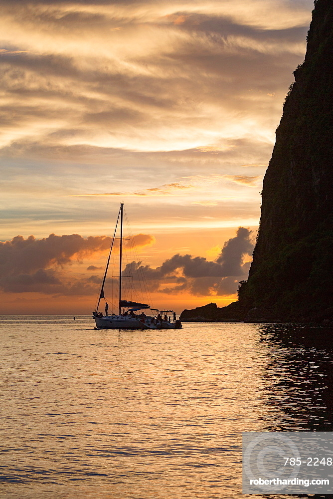 Boat moored at the base of Petit Piton near Sugar Beach at dusk, St. Lucia, Windward Islands, West Indies Caribbean, Central America