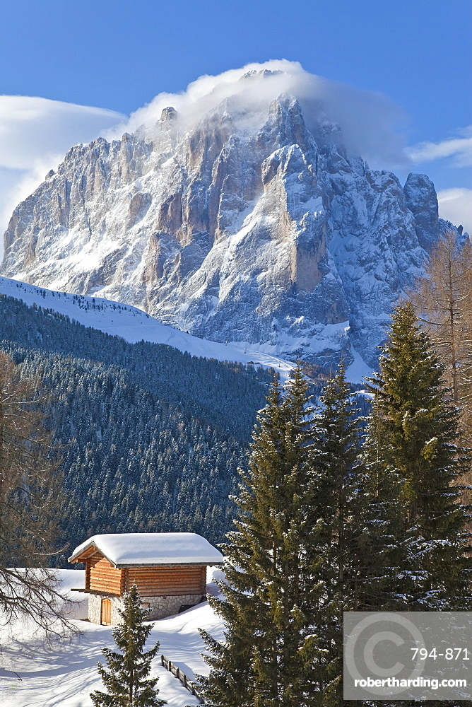 Winter snow covered mountain hut in front of Sassolungo mountain, 3181m, Val Gardena, Dolomites, South Tirol, Trentino-Alto Adige, Italy, Europe