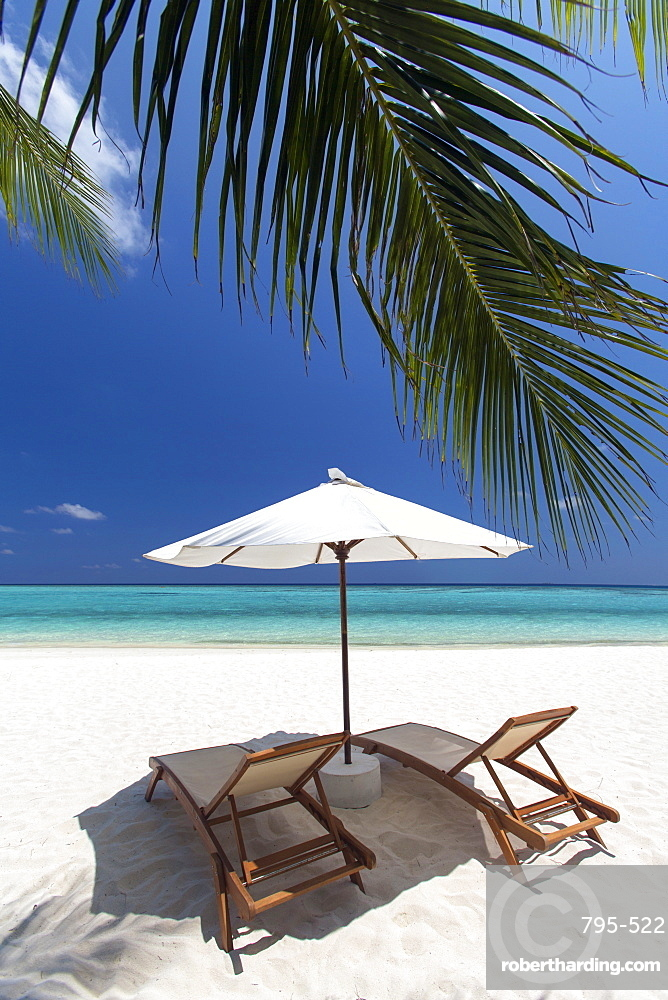 Lounge chairs on tropical beach, Maldives, Indian Ocean, Asia