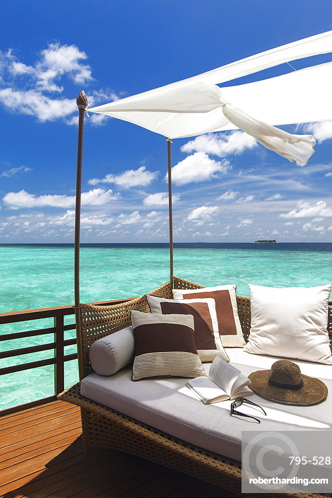 Sofa overlooking ocean, Maldives, Indian Ocean, Asia
