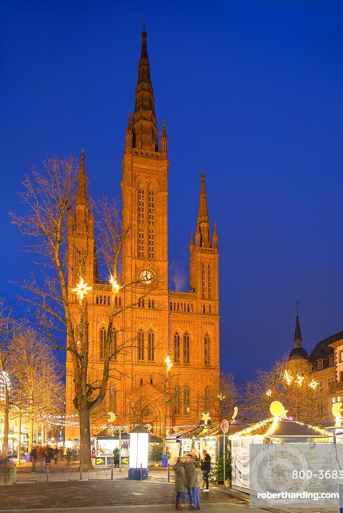 Christmas market and Marktkirche (Market Church) at dusk, Wiesbaden, Hesse, Germany