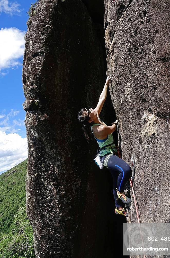 Rock climber in action at Anhangava, Curitiba, Brazil, South America