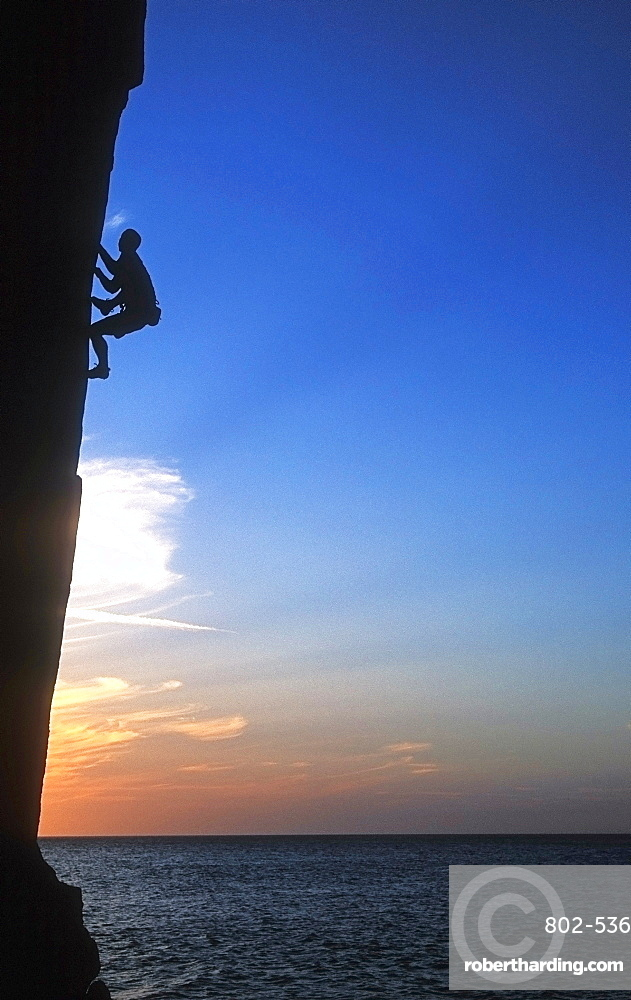 Rock climber in action, Lundy Island, Bristol Channel, United Kingdom, Europe