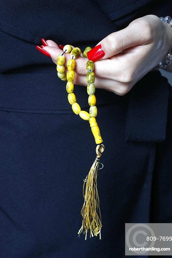 Close-up of Muslim woman holding Islamic prayer beads, Vietnam, Indochina, Southeast Asia, Asia